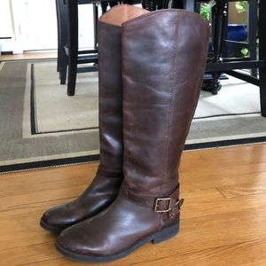 Lucky tall brown leather boots. 🍀